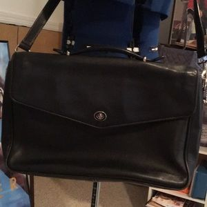 Black leather Coach briefcase with shoulder strap